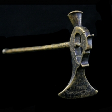 A Persian brass jewellers hammer with zoomorphic terminal