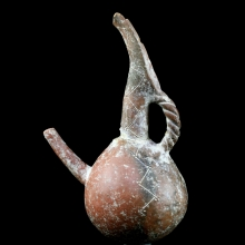 A Cypriot bronze age red ware spouted vessel with incised decoration