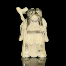 Japanese painted ivory Netsuke carving of an old  woman with swivel face