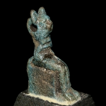 Late to Ptolemaic Period blue green faïence amulet of a seated Bastet figure