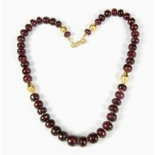 A necklace comprising Indian natural ruby round beads with gold elements