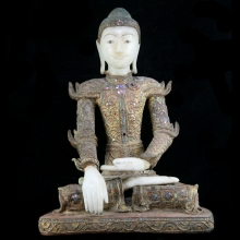 A finely crafted Mandalay alabaster and wooden figure of a seated Buddha