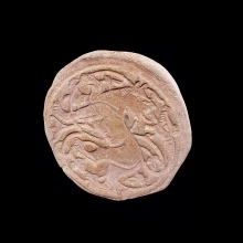 a-beautiful-early-islamic-clay-seal,-depicting-a-lion-and-serpent-in-combat_09661b