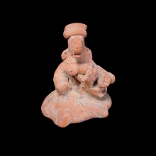 A Gupta red terracotta zoomorphic mother goddess nursing young.