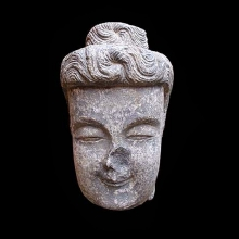 A large Chinese finely carved grey/black lime-stone head of Buddha