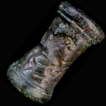 A very large Iranian bronze cylinder seal, the imprint depicting two handlers controlling a lion and zebu bull.