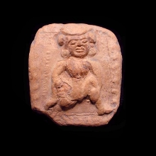 An ancient Indian clay plaque showing an erotic scene with female figure.