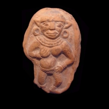 An ancient Indian clay plaque showing an erotic scene with single female figure.
