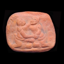 An ancient Indian clay plaque showing an erotic scene with two male figures