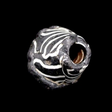 An early Islamic mosaic glass bead.