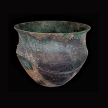 An Indo-Iranian bronze vessel with incised linear decoration at mid-section