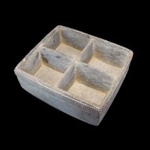 Bactrian grey schist cosmetic vessel with four compartments.