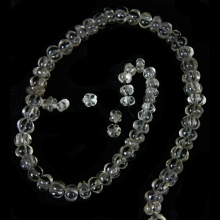 A strand of smoky quartz melon shaped beads.