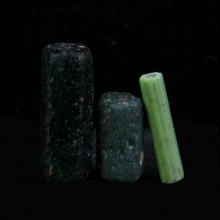 A group of three Romano-Egyptian glass barrel beads