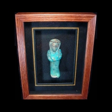 Egyptian deep azure glazed faience ushabti with details in a black glaze presented in box frame.