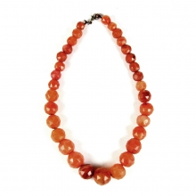A strand of Romano-Egyptian faceted carnelian beads