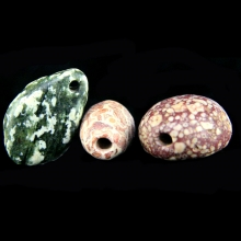 A group of three Neolithic stone beads