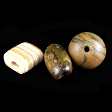 A group of three ancient stone beads, Mesopotamia