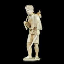 A finely carved Japanese ivory Okimono of a man carrying a trussed goose on his back.
