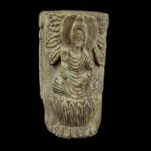 Gandharan bone bead depicting a seated Buddha flanked by attendants