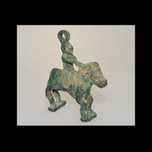 Greek Bactrian bronze pendant amulet in the form of a horse and rider.