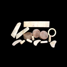 Han or earlier collection of fifteen jade and stone body pieces, ear plugs, nose plugs, eye coverings etc.
