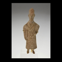 Indus Valley wooden figurine in the form of a standing female