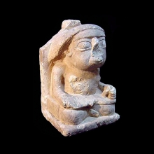 Limestone seated figure of a scribe
