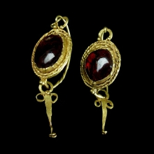 Pair of Roman Egyptian gold and garnet earrings.