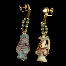 Rare Byzantine to Islamic pair of earrings comprising coloured glass paste miniature handled jug beads
