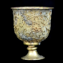 A Chinese Tang Dynasty gilt brozne stem cup.