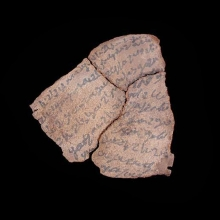 Three Romano-Egyptian leather fragments with Demotic inscriptions in ink.