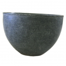 A Bactrian carved grey stone bowl.
