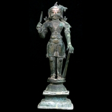 Bronze statuette of a warrior king holding weapons