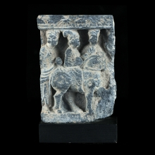 Gandharan grey schist fragment depicting Siddharta on horse-back flanked by attendants.