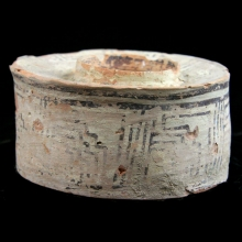 An Indus Valley painted pottery jar with geometric designs in brown pigments