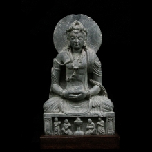 A Gandharan Schist figure of a seated Bodhisattva