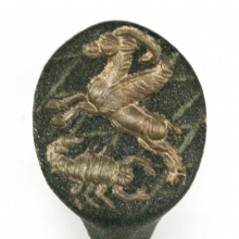 A Sassanian bronze ring depicting a winged gazelle and scorpion