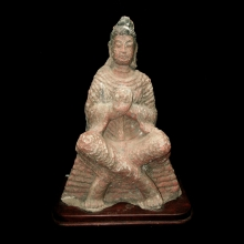 A Northern Wei Dynasty painted stone seated Buddha