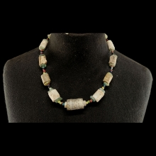 Cambodian mixed bead necklace comprising fossilised coral and glass