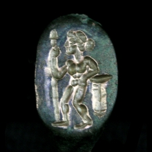Greek bronze ring, the bezel engraved with an Amazon standing warrior holding a spear.
