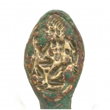 Hellenistic bronze ring with a depiction of a kneeling figure