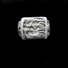 A Greek silver ring the intaglio depicting Eros on horseback.