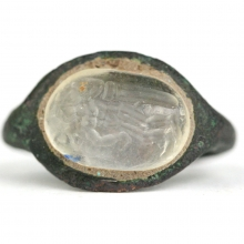 A Roman bronze ring with rock crystal bezel and engraved with a depiction of a Woman.