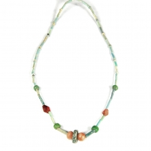 An Egyptian faïence, carnelian, and glass bead necklace.
