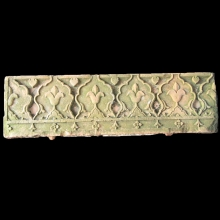 A finely carved sandstone architectural element, a panel carved with a foliate frieze