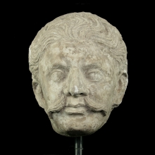 A fine Gandharan stucco head of a soldier