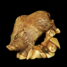 Japanese ivory Netsuke carving of a wild boar trampling a peasant,  Edo