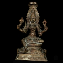 A bronze statue of Durgha surmounted by a five headed naga, holding various attributes