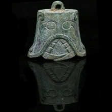 A Shang Dynasty bronze bell engraved with masks.